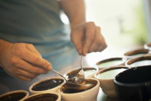 coffee-tasting-with-hands-holding-spoons-300x200
